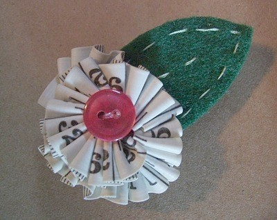 Flower pin or magnet made with a sewing tape measure.