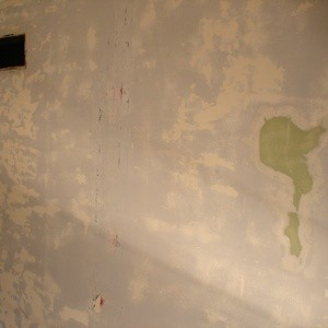 Wall prepped for painting after removing wallpaper.