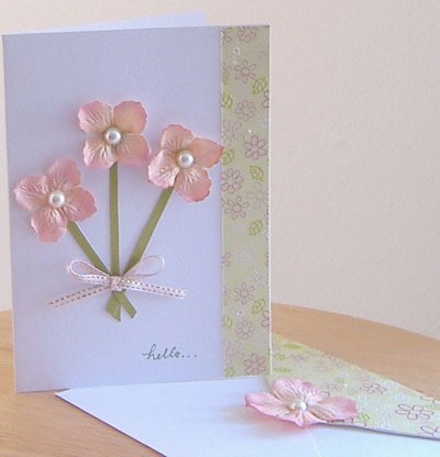 Greeting card with pink flowers.