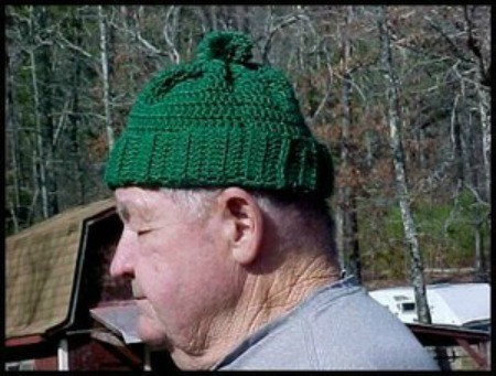 man wearing a green ski hat