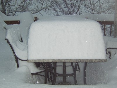 Snow covered table on deck.