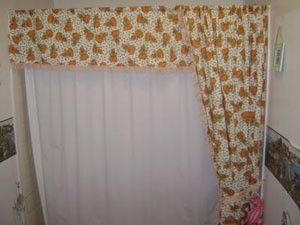 Homemade shower curtain with fall motif.
