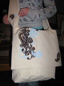 Iron on decorations on messanger bag.