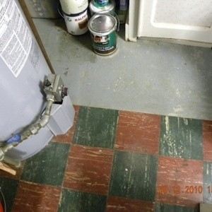 Concrete and linoleum tile floor.