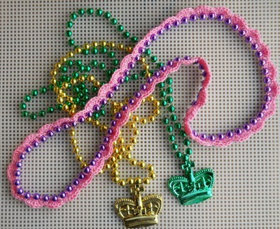 Gold, pink, and green necklaces.