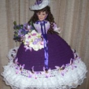 doll with crocheted skirt