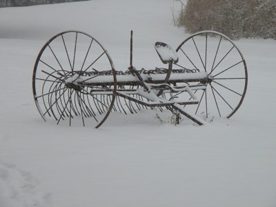 Snow covered farm rake.