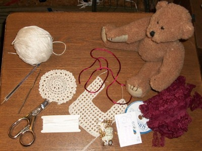 Teddy bear with crochet bib.