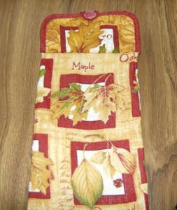Potholder topped kitchen towel.