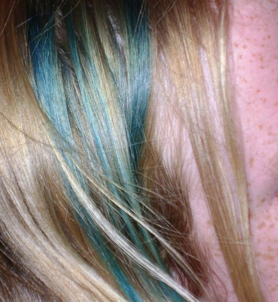 Green streaks in blond hair.