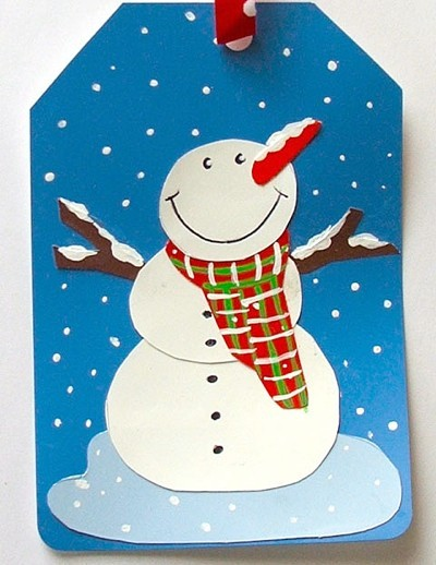 gift tag with snowman made from recycled paint chips, ribbon, and paint