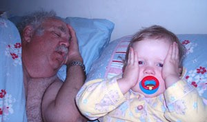 sleeping grandpa and baby