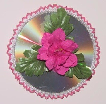 A recycled CD as a floral wall hanging.