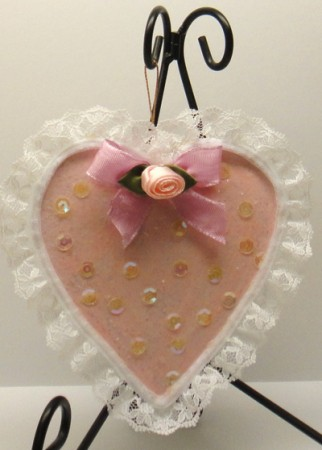 Lace edged pink heart ornament.
