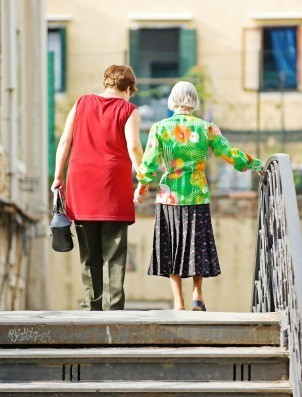 Elderly Woman Walking with Daughter