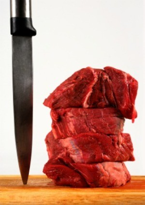 A stack of raw beef tenderloin.