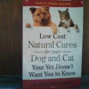 "Book titled ""Low Cost Natural Cures for your Dog And Cat"""