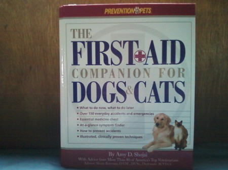 "Book titled ""The First Aid Companion for Dogs and Cats"