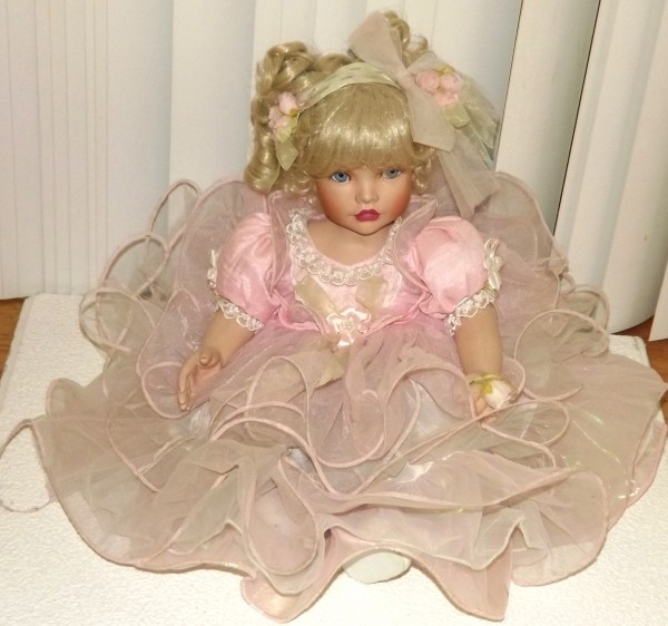 Doll in tiered pink dress.
