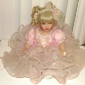 Paradise Galleries Doll. Doll in tiered pink dress.