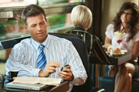Man Using Smartphone in Coffee Shop