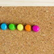 push pins on a bulletin board