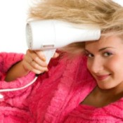 girl blow drying her hair