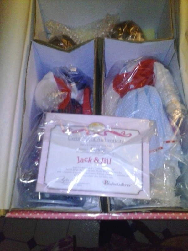 Two dolls in box.