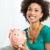 A woman holding a piggy bank.