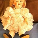 Doll in ruffly dress.