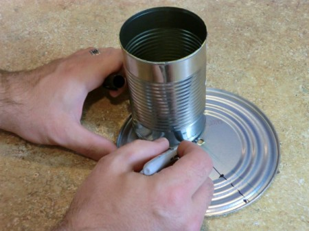Find the center of the large can lid.