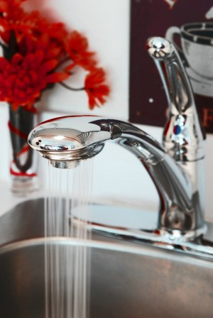 Faucet running in a kitchen that uses well water.
