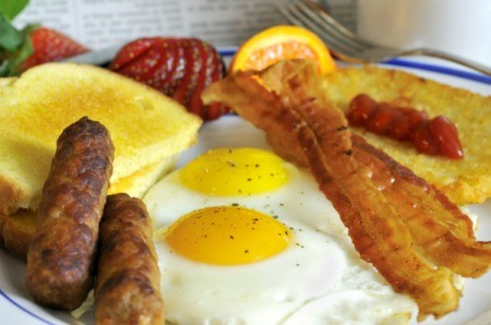 An egg, sausage, bacon and hash brown breakfast.