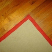 A carpet remnant turned into an area rug or doormat.