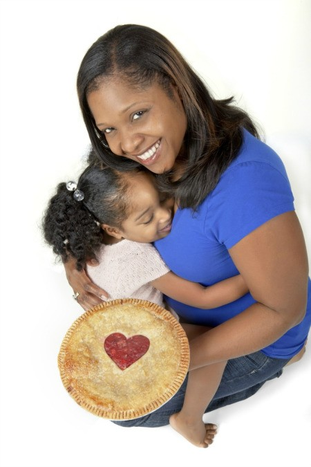 Woman and Daughter and Pie Cooked with Love