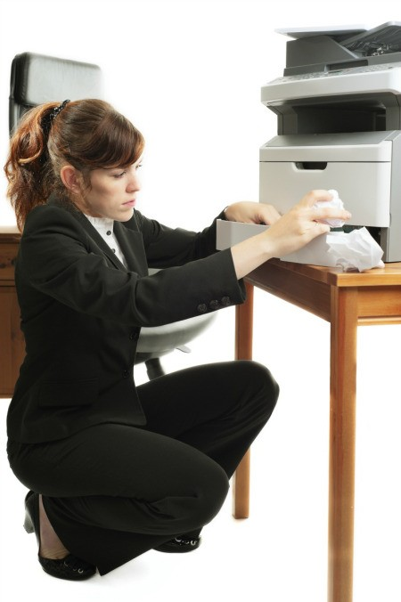 Woman Fixing a Printer That Won't Print