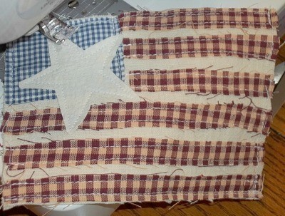 Primitive Applique Flag Pillows - Sewing on star.