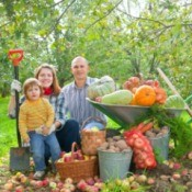 Family with Garden Harvest