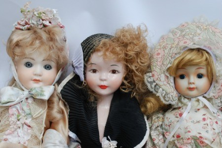 Photo of 3 vintage porcelain dolls.
