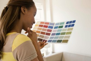 a woman looking at paint swatches.