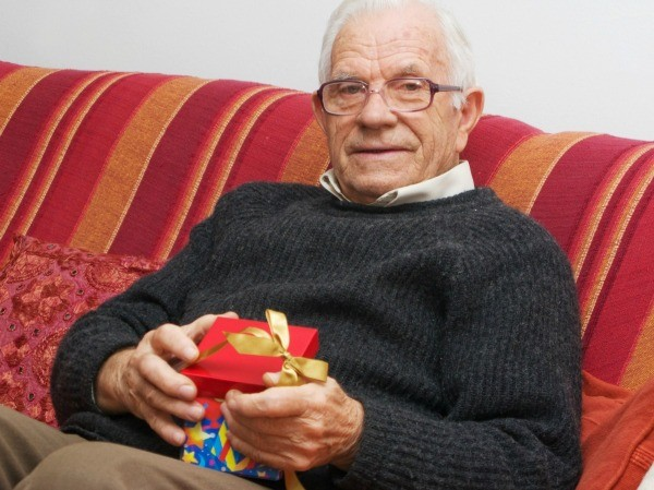 elderly man with a gift