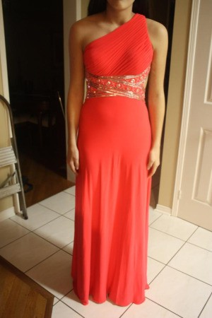 Salmon colored prom dress.