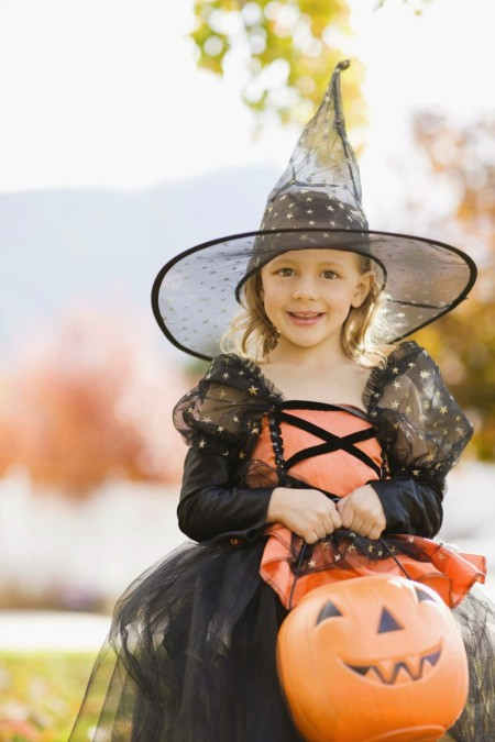 Girl in a witch costume.