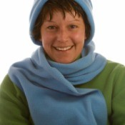 Woman wearing a fleece scarf.