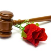 A courthouse gavel and a red rose.