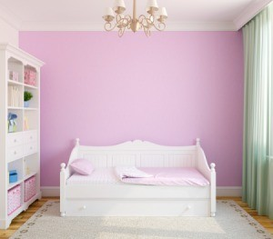 Nursery with pink walls.
