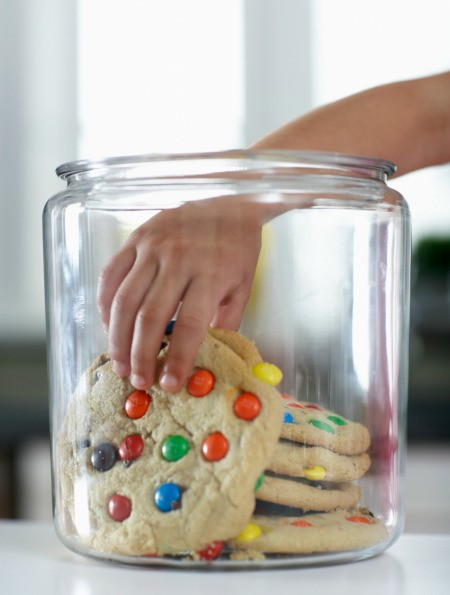 Large cookies in a cookie jar.