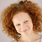 Girl with red curly hair.