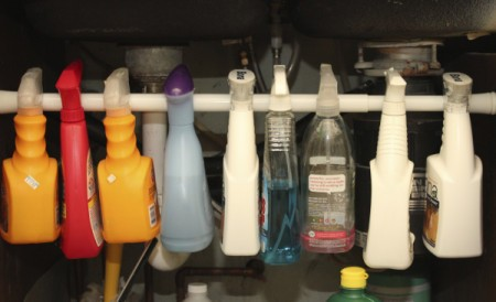 Closeup view of hanging spray bottles.
