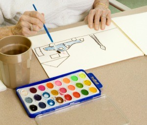 Adult painting a picture with watercolors.